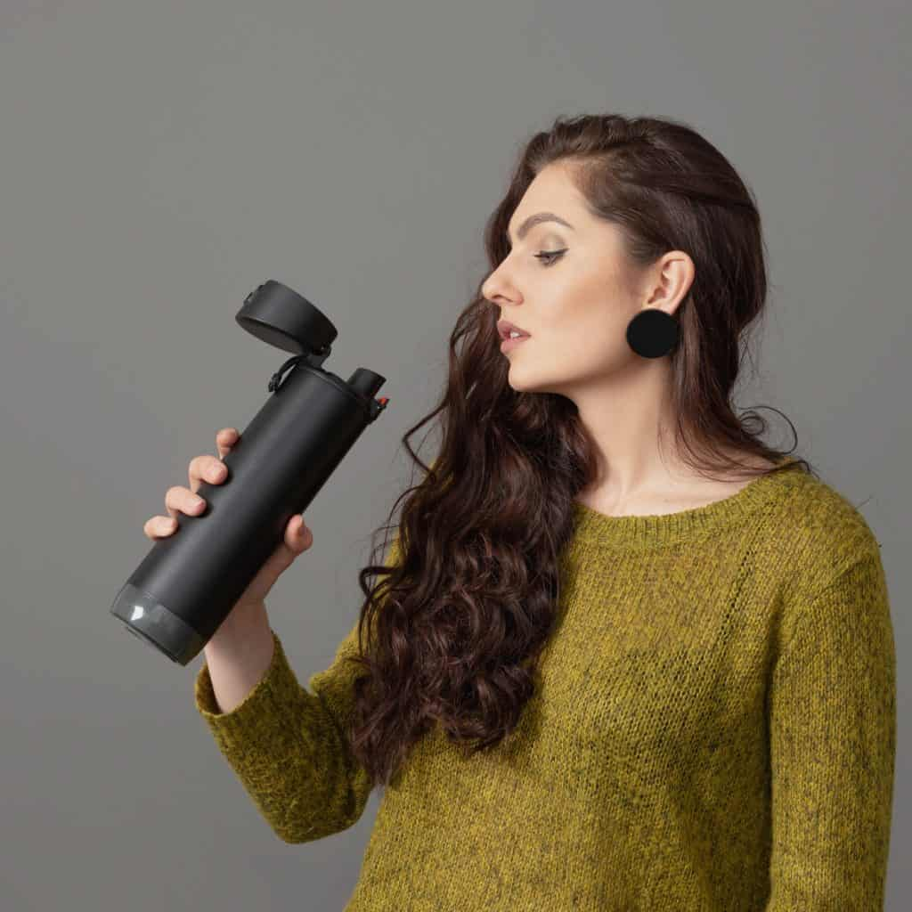 Woman Holding Eco Reusable Smart Thermo Water Bottle With Drink Reminder, Healthy Lifestyle Concept